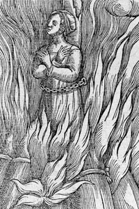 A woman being burnt at the stake.