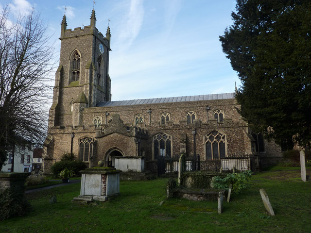 A photograph of St Andrew's church, Halstead, showing some of the graves in the churchyard.