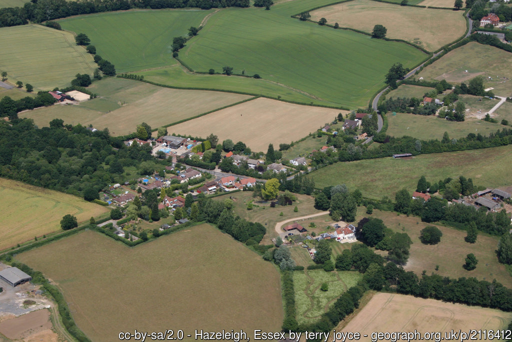 Aerial view of Hazeleigh, a small village surrounded by fields.