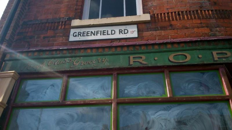 Close up of the R O Price grocer's shop sign