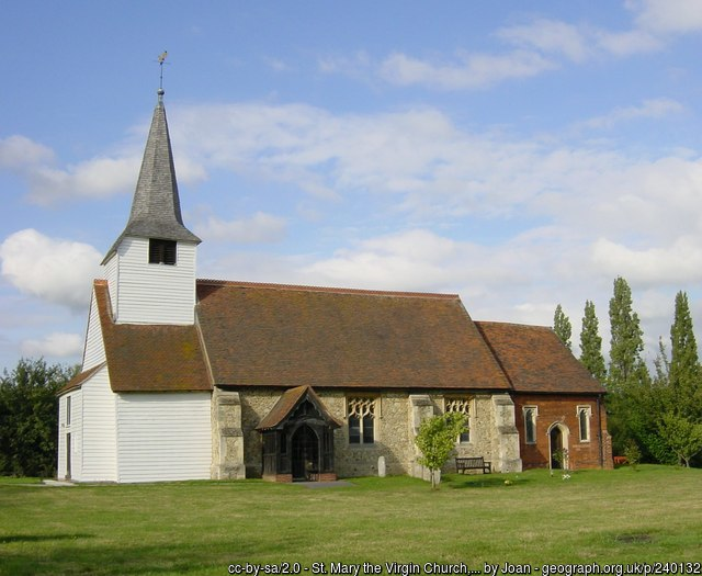 The church - wooden at one end, stone in the middle, brick at the other end.