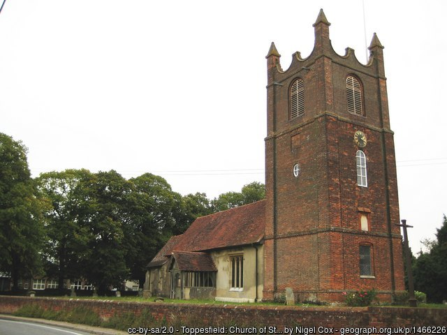 The church at Toppesfield, with its large brick tower and older nave.